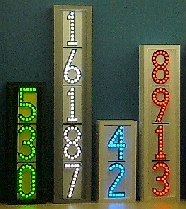 Group of 4 vertical LEDress lighted house numbers at night