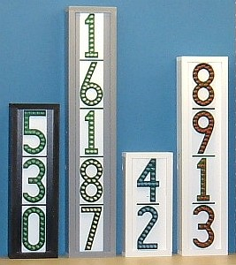 Group of 4 vertical LEDress lighted house numbers, daytime