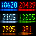 Horizontal lighted house numbers showing LED colors